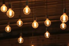 Vintage glowing light bulbs hanging. Decorative antique style light bulbs.  royalty free stock photography