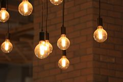 Vintage glowing light bulbs hanging. Decorative antique style light bulbs.  stock photos