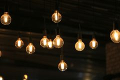 Vintage glowing light bulbs hanging. Decorative antique style light bulbs.  royalty free stock image