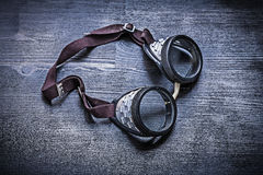 Vintage goggles on wood board Stock Photos