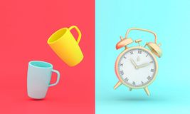 Vintage gold alarm clock and stylized cups on two-tone background, flat lay style stock photo