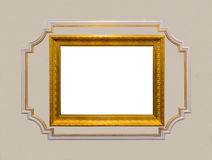 Vintage gold carved wooden frame with blank white center surrounded stock photography