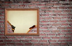 Vintage gold frame with burned on wall Stock Photo