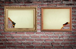 Vintage gold frame with burned on wall Stock Photos