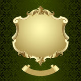 Vintage gold framed shield with banner on dark green baroque orn Royalty Free Stock Photography