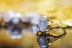 Vintage gold Jewelry blue sapphire rings with reflection. On black background Royalty Free Stock Photography