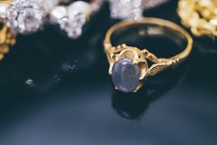 Vintage gold Jewelry blue sapphire rings with reflection. On black background stock photos