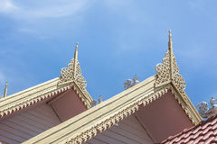 Vintage gold lai thai pattern on the roof of building in wat sareesriboonkam in lampoon temple public location at noon sun light Stock Photo
