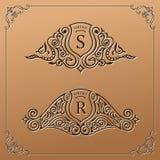 Vintage gold logo set. Flourishes crest calligraphic ornament Royalty Free Stock Images