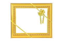 Vintage gold picture frame and golden ribbon Stock Image