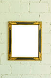 Vintage gold picture frame on white wall Stock Image