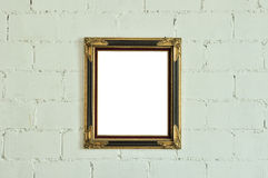 Vintage gold picture frame on white wall Royalty Free Stock Photos