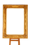 Vintage gold picture frame with wooden easel Stock Photos