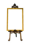 Vintage gold picture frame with wooden easel Royalty Free Stock Photos