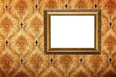 Vintage gold plated picture frame  on wall Royalty Free Stock Images