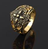 Vintage gold ring. On black Royalty Free Stock Image