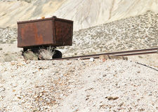 Vintage gold & silver ore cart. Red rusted vintage gold and silver ore cart abandoned in Nevada desert royalty free stock photography