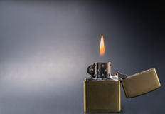 Vintage gold style lighter with flame close up royalty free stock photo