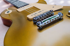 Vintage gold top single cutaway guitar on wood surface Stock Photo