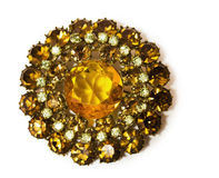 Vintage golden brooch with gems in the shape of a flower Royalty Free Stock Images