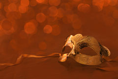 Vintage golden carnival mask. With lights on the background Royalty Free Stock Image