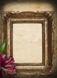 Vintage golden frame on grunge background. With pink flower Stock Photography