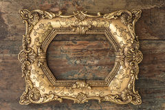 Vintage golden frame on wooden background. Grunge texture Royalty Free Stock Images