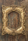 Vintage golden frame on wooden background. Grunge texture. Vintage golden frame on wooden background. Grunge wood texture Royalty Free Stock Image