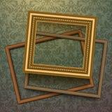 Vintage golden frames on floral background Stock Photography