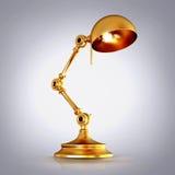 Vintage golden lamp on grey background Royalty Free Stock Photo