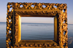 Vintage golden picture frame and sea landscape Royalty Free Stock Image