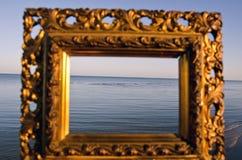 Vintage golden picture frame and sea landscape Royalty Free Stock Image