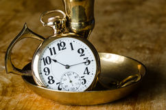 Vintage Golden Pocket Watch Resting in a Brass Candlestick Holder Stock Photography