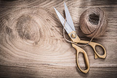 Vintage golden scissors hank of rope on wooden board Royalty Free Stock Images