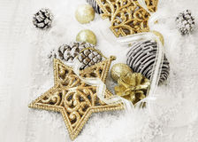 Vintage Golden Shiny Christmas Decorations in the Snow with Eleg Royalty Free Stock Photo