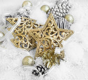 Vintage Golden Shiny Christmas Decorations in the Snow with Eleg Royalty Free Stock Image