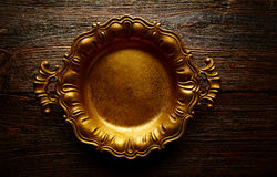 Vintage golden tray round on aged brown wood royalty free stock image