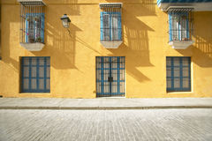 Vintage golden yellow Colonial building with archways in Old Havana Cuba Royalty Free Stock Photos