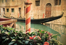 Vintage gondola moored - Venice, Italy Stock Images