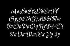 Vintage gothic old style typeface on dark background Royalty Free Stock Photo