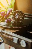 Vintage gramophone and flowers. Vintage gramophone with a vinyl and flowers stock photos