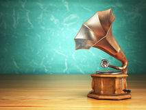 Vintage gramophone on green background. Royalty Free Stock Photography