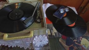 Vintage gramophone. With a vinyl disk and old glasses stock video footage
