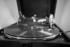 Vintage gramophone with a vinyl. Monochrome Royalty Free Stock Images