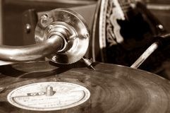 Vintage gramophone with a vinyl. Sepia Stock Photo