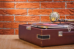 Vintage gramophone on wooden table close up view Royalty Free Stock Photos