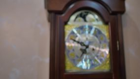 Vintage grandfather clock ticking on wall stock video footage