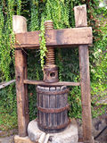 Vintage grape press for wine making. Manual grape press made of wood used in the past Royalty Free Stock Photography