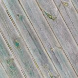 Vintage gray diagonal wooden boards with the remains of the green paint Royalty Free Stock Images