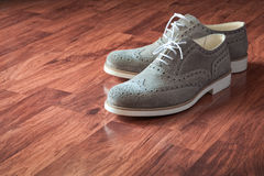 Vintage gray leather pair of shoes Royalty Free Stock Photography